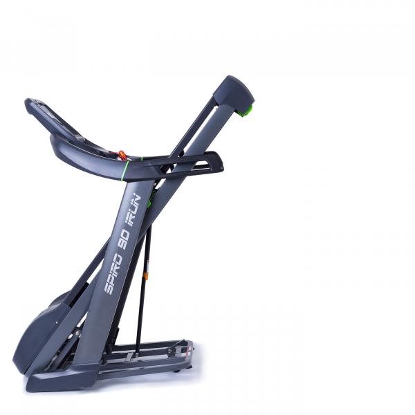 Běžecký pás Housefit Spiro 90 iRun sklopený na transportním kolečku