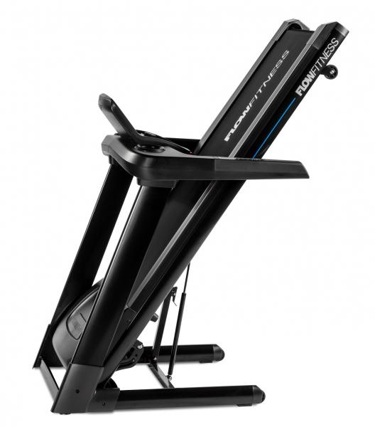 Běžecký pás Flow Fitness T2i složený z boku